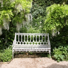 White furniture can be hard to place in a garden, add white plants to settle it in