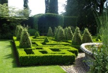 The Chinese Paterrre garden has box topiary and ivy arbours